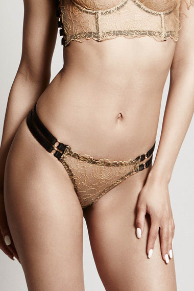 Edge o' Beyond Lingerie. The Valma thong is made with delicate gold thread, a rose floral design and bondage inspired strapping. A close up view