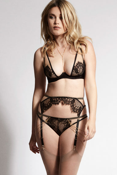 Edge o' Beyond's Kathryn Brief Designed with dramatic cut outs, black satin bound edges and a fishnet style scalloped lace.