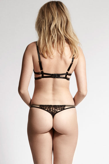 Designed with dramatic cut outs, satin bound edges and a fishnet style scalloped lace, the Kathryn thong plays with positive and negative space to create high drama lingerie