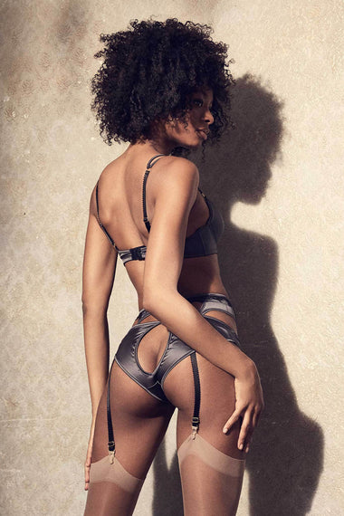 Back view of The Edge o' Beyond Miline bra is structured in silky satin and black French Leavers lace. This lingerie is a push up bra with padding. Shown with full underwear set suspender, brief and stockings