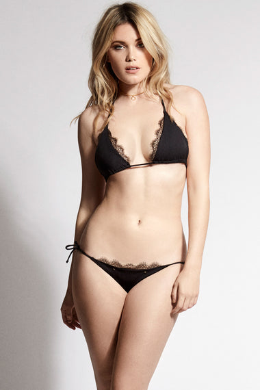 Black lace tie side bikini briefs. Nadine is the debut swimwear collection from luxury lingerie brand Edge o' Beyond. Worn with triangle bikini top