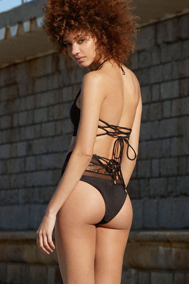 The Stephanie long-line bikini top. A bralette shape with halter neck combine to create a high impact, figure flattering swimwear style. Back view shown on lingerie model with high waist bikini bottom