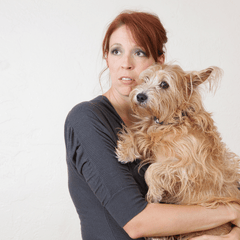 WOMAN WITH ANXIOUS DOG