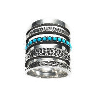 https://www.janeleslieco.com/products/pamela-love-single-cage-ring-with-turquoise