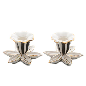 https://www.janeleslieco.com/products/mackenzie-childs-mod-flower-candle-holders-set-of-2