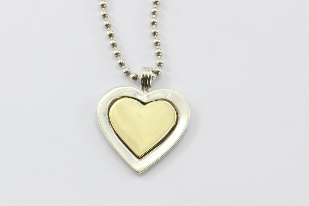 Vintage tiffany co sterling silver 18k gold heart pendant aloadofball Images