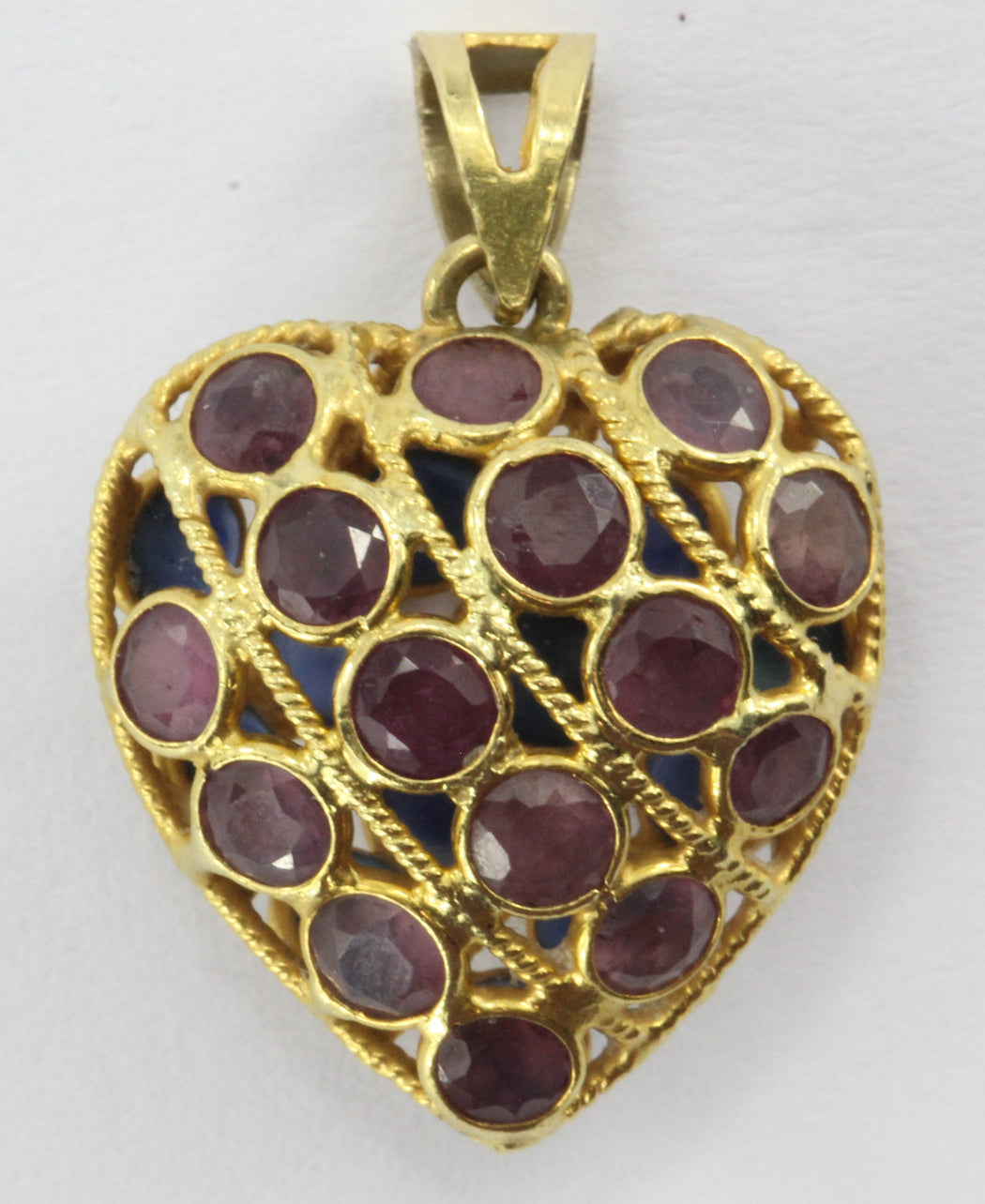 18k yellow gold ruby and sapphire double sided puffy heart charm - Queen May