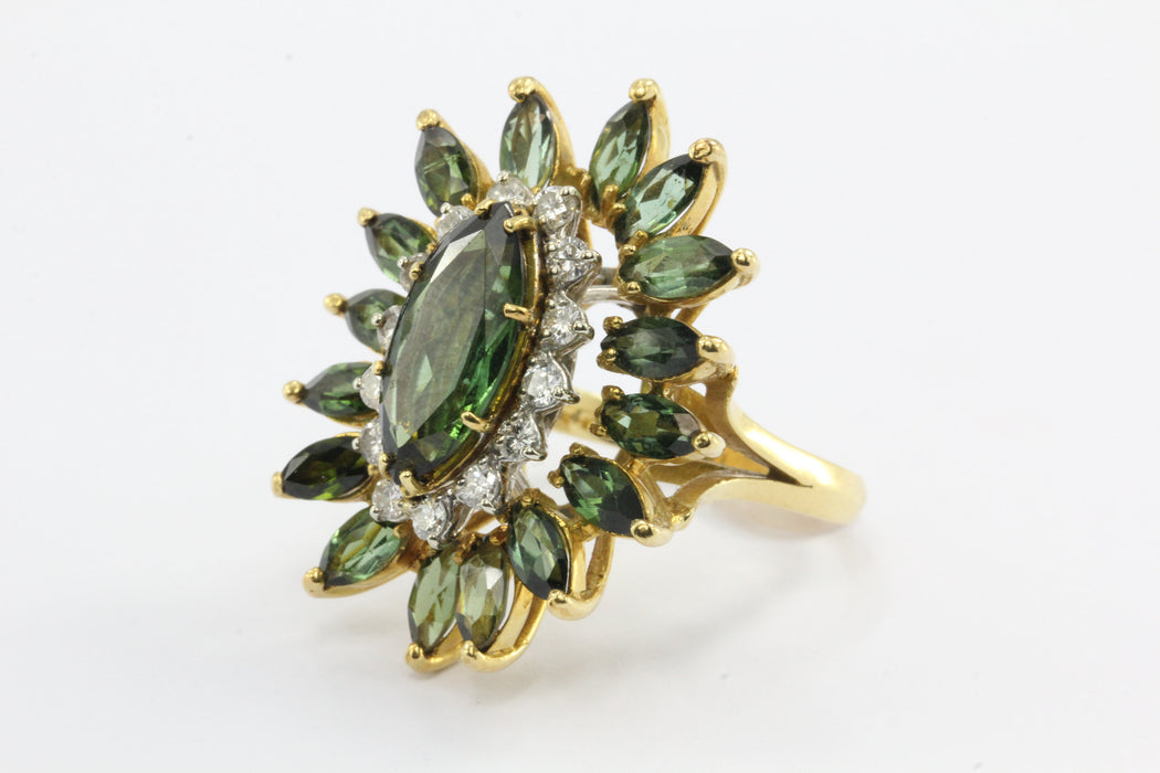 A 18k natural green tourmaline and diamond ring featuring 6.44 carats tw with laboratory appraisal