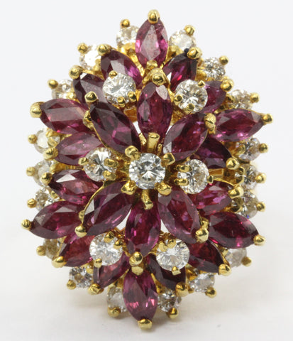 An 18k natural ruby and diamond cocktail ring featuring 5 carats of rubies and 1 carat of diamonds.