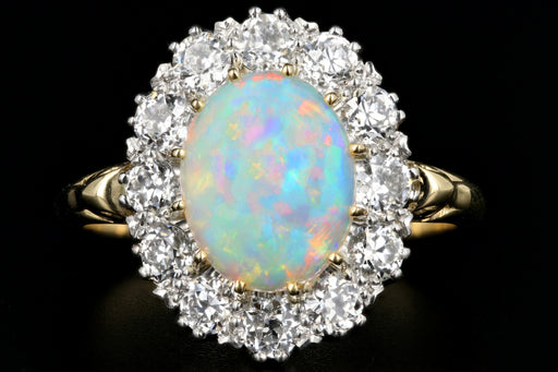 Victorian Style 18K Yellow Gold and Platinum 1.68 Carat Oval Cut Opal and Diamond Ring