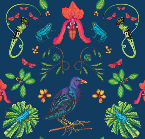 A tropical bird fabric with other tropical creatures including frogs and foliage are illustrated on a blue background