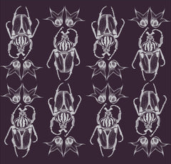 Illustrated silver beetle wall hanging with a royal purple background