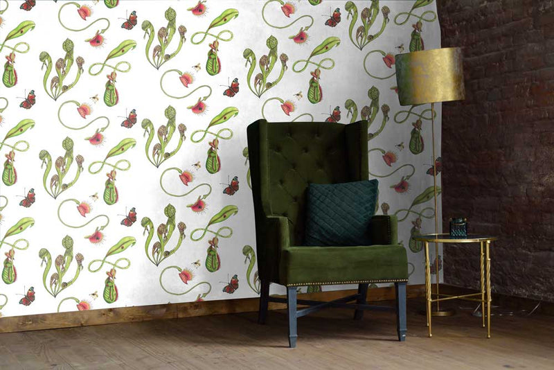 Carnivorous plants wallpaper shown in living room with a green armchair, lamp and side table. Wallpaper is colour illustration on a white background