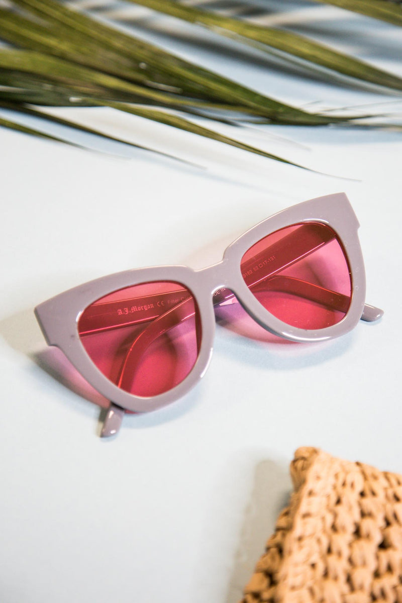 pink tinted sunglasses w/grey frame