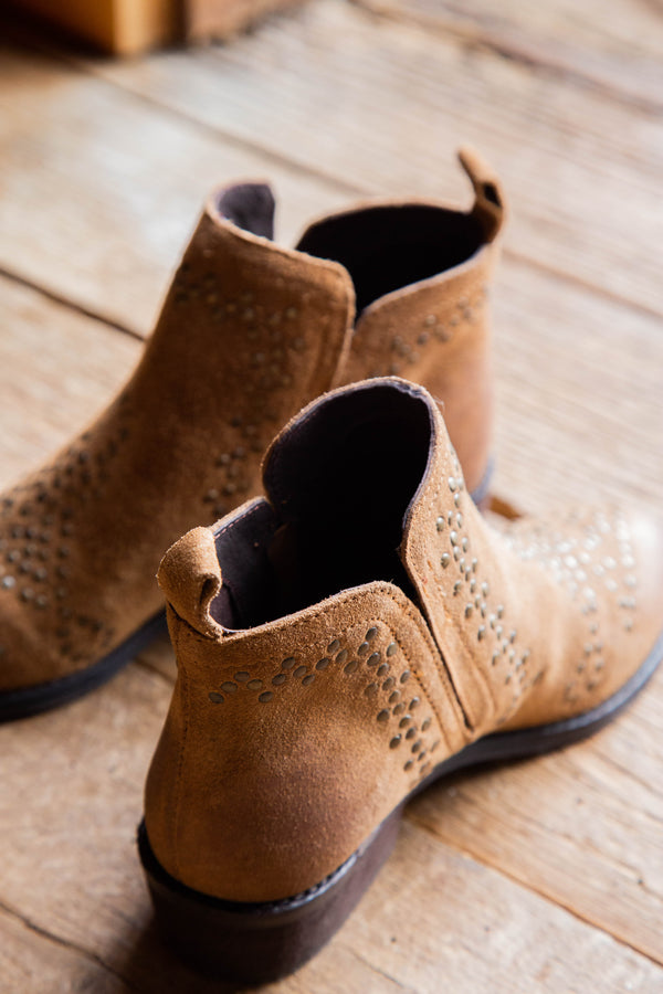 Tan studded bootie by Sbicca