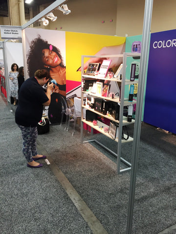 Krystal from Polished Galore takes photos of our display!