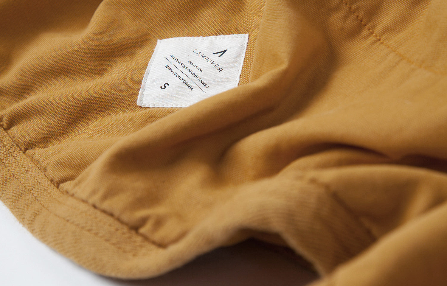 All Purpose Field Blanket in Gold by Campover | Label detail & lifestyle