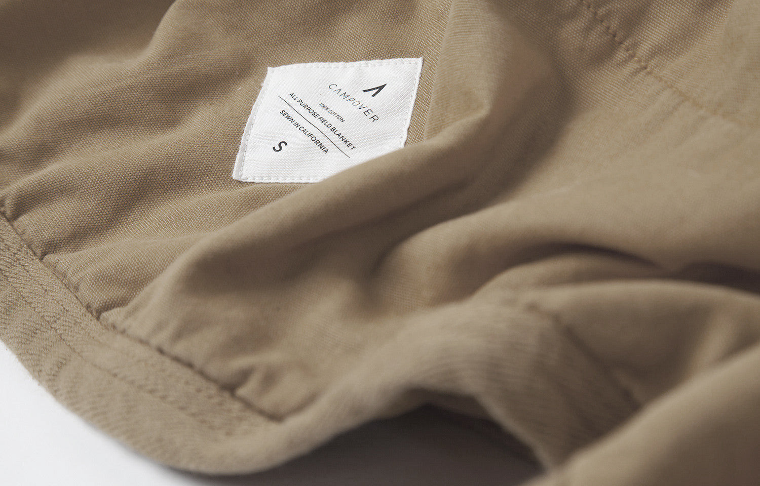 All Purpose Field Blanket in Sand by Campover | Label detail & lifestyle