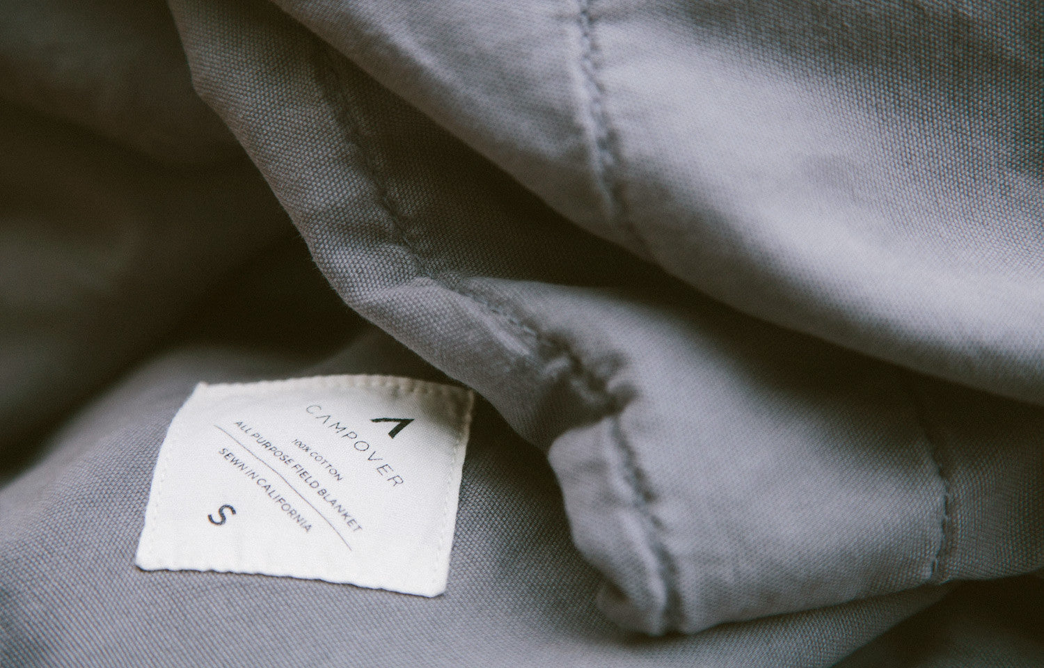 All Purpose Field Blanket in Grey by Campover | Label detail & lifestyle