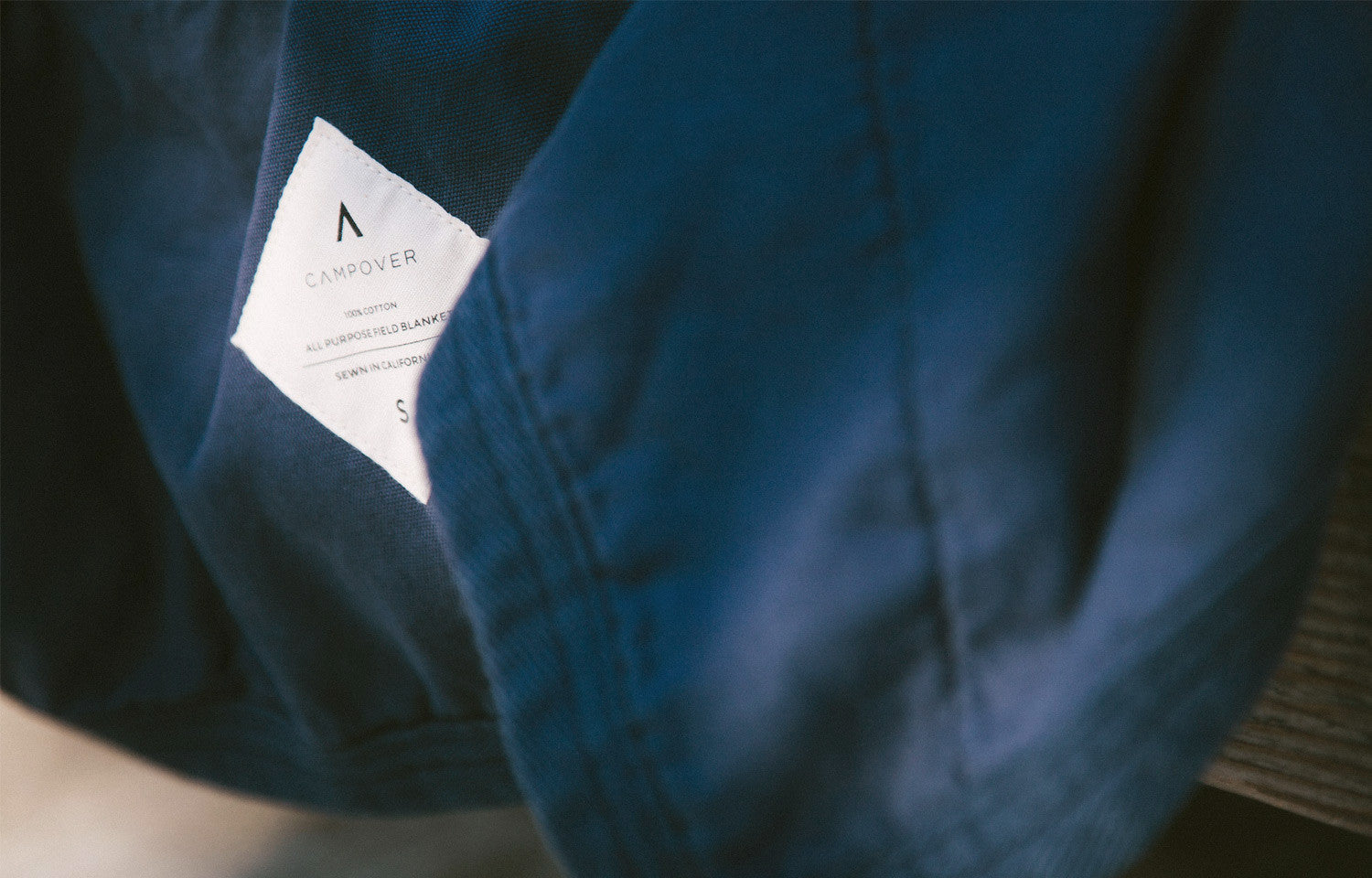 All Purpose Field Blanket in Navy by Campover | Label detail & lifestyle