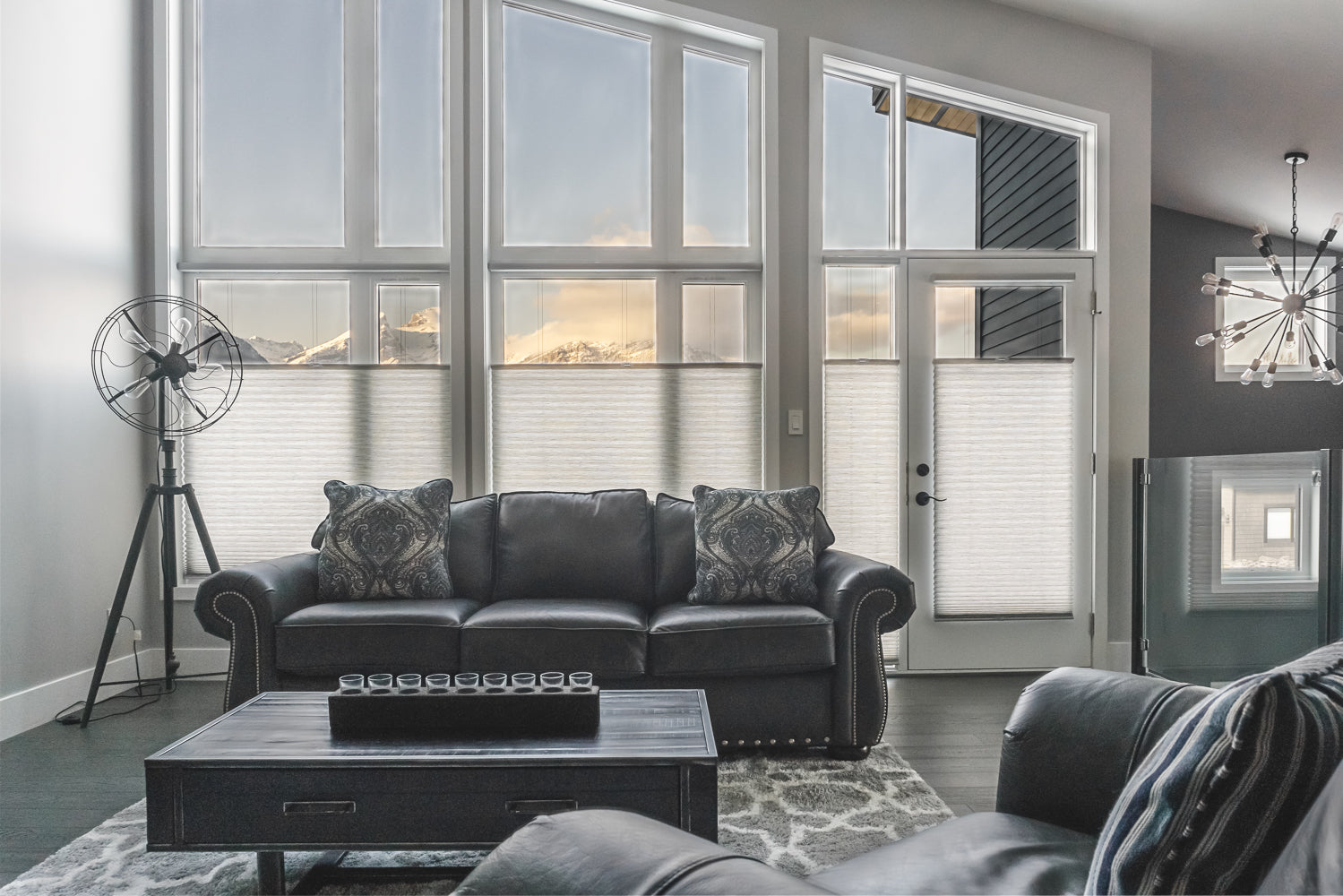 Living room scene in Fernie BC showing top down bottom up window shades and views of the Three Sisters rocky mountains.