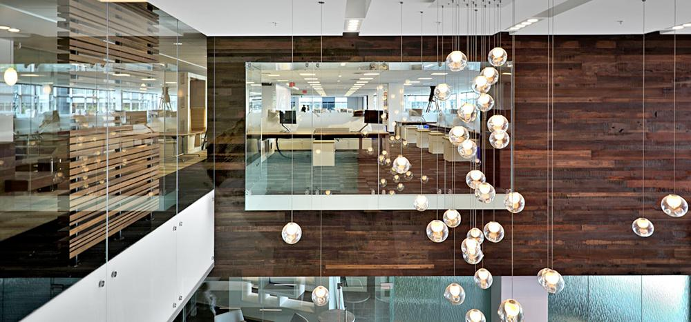 Reclaimed wood feature wall and modern lighting interior design project HSBC head office Virtual Way Vancouver British Columbia.