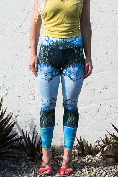 Full length legging printed with a landscape painting of Joffre Lakes by Heidi Denessen. Aqua blue, green, gold. Mountain, lake, trees. Made in Canada. Sustainable.