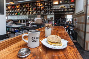 A breakfast sandwich and coffee at See See