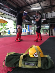 muay thai training - yoga bag - boxing gloves - fight for education - purnama