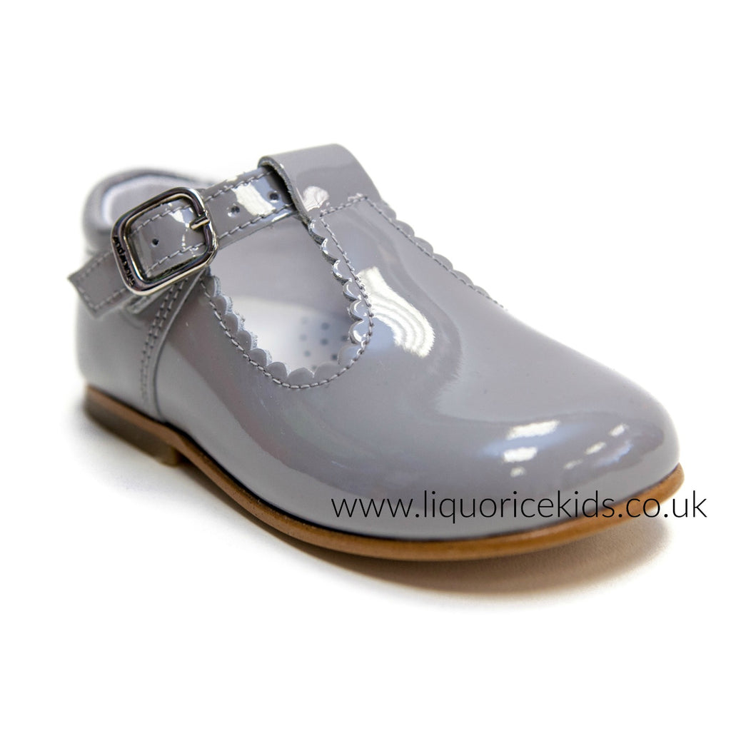 Andanines Girls Ice-Grey Patent T-Bar Shoes With Scallop Edging.