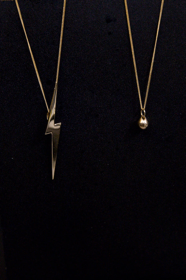 Edge Only jewellery 14 carat gold teardrop and 14 ct gold Skinny lightning bolt pendants