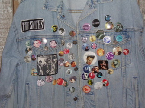 Denim jacket with badges and pins