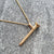 Edge Only Round-head Screw Pendant in 14 carat gold. Hallmark