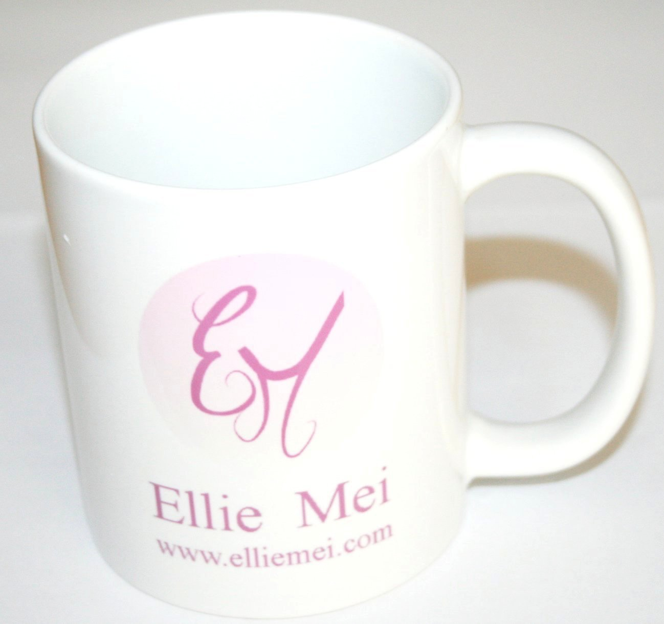 This classic  white  mug style will inspire you to settle in with something warm or cold beverages. It feature with our  fashion art  logo  , perfect for christmas  or other holidays.birthday gift. Your must have list .