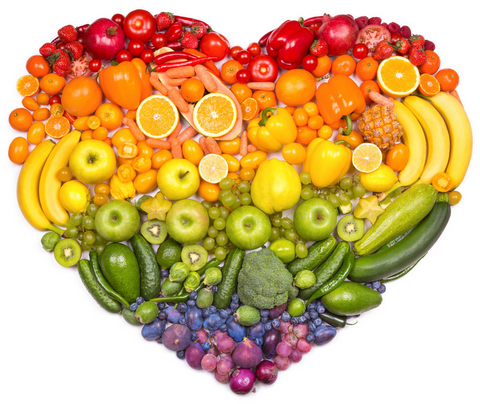 Different fruit and veggies laid out in a heart shape