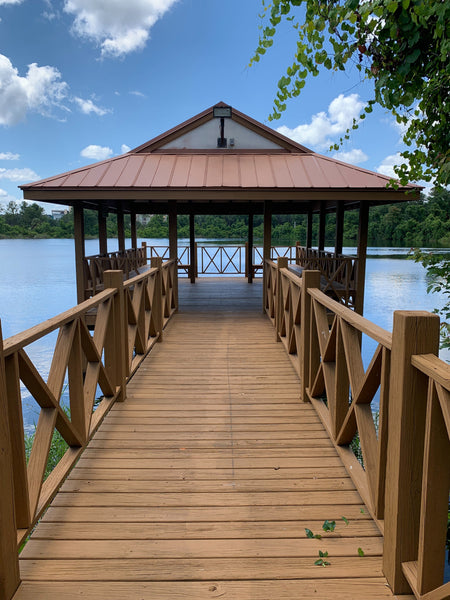 Take shade from sun in a gazebo to protect your skin from summer sun spots