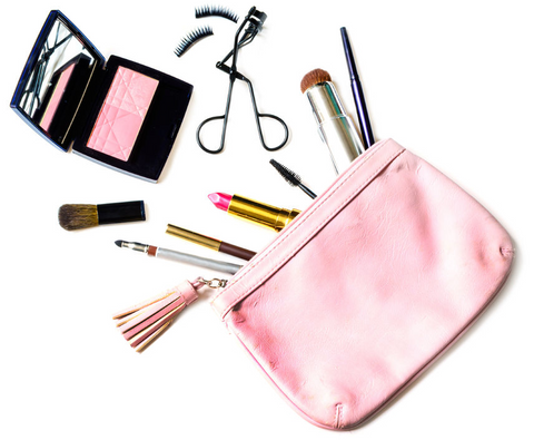 Makeup bag with brushes and spilling out