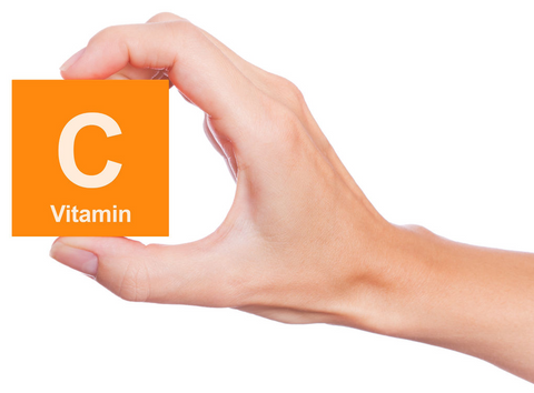 "Person holding block labeled ""Vitamin C"""