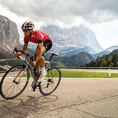 A rider in mountains on a Cannondale SuperSix Evo Hi Mod bike