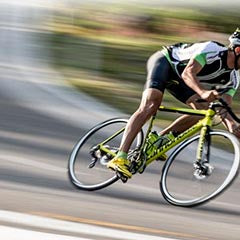 rider racing downhill on yellow Cannondale CAAD12 bike