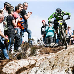 Group watching BMX rider on rocks on Cannondale Overmountain bike