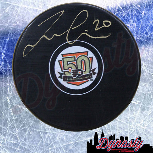 Taylor Leier Autographed Philadelphia Flyers 50th Anniversary Hockey Puck - Dynasty Sports & Framing