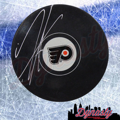 Travis Sanheim Philadelphia Flyers Autographed NHL Hockey Logo Puck - Dynasty Sports & Framing