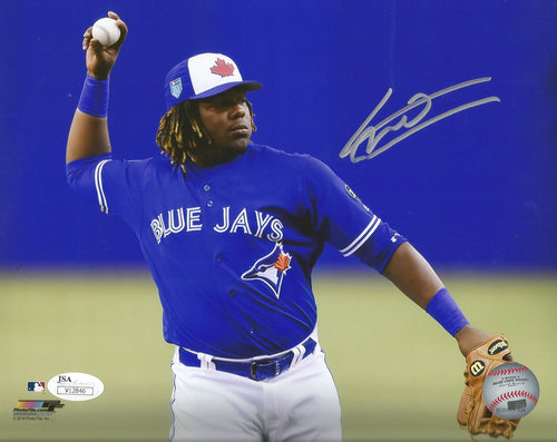 Vladimir Guerrero, Jr. Fielding Toronto Blue Jays Autographed MLB Baseball Photo - Dynasty Sports & Framing