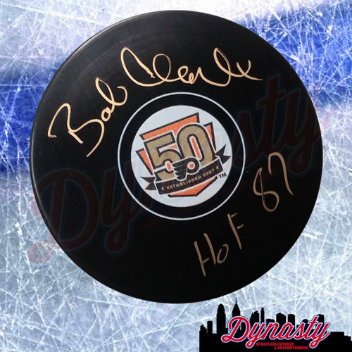 Bob Clarke Autographed 50th Anniversary Philadelphia Flyers Hockey Puck with HOF Inscription - Dynasty Sports & Framing