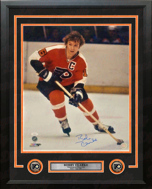 "Bob Clarke Skating in Orange Philadelphia Flyers Autographed 16"" x 20"" Framed Hockey Photo - Dynasty Sports & Framing"