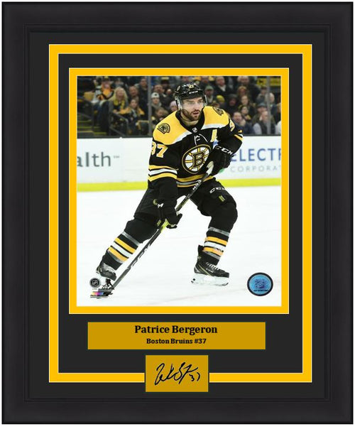 "Patrice Bergeron Boston Bruins in Action NHL Hockey 8"" x 10"" Framed and Matted Photo with Engraved Autograph"