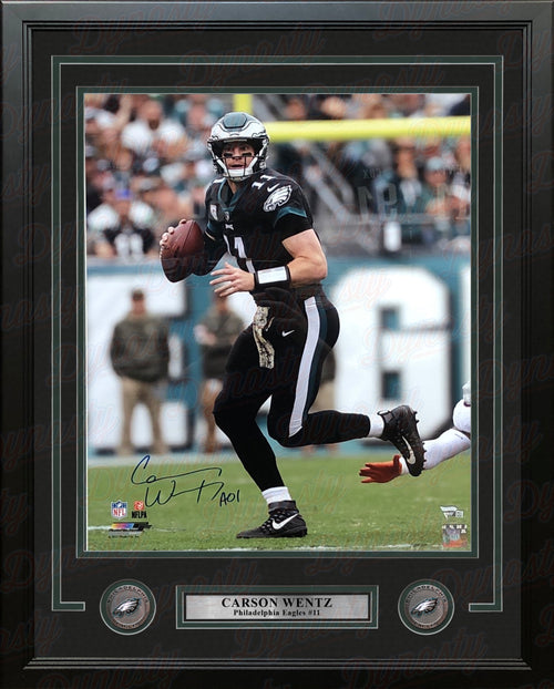 "Carson Wentz in Black Philadelphia Eagles Autographed NFL Football 16"" x 20"" Framed and Matted Photo - Dynasty Sports & Framing"