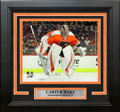 Carter Hart Philadelphia Flyers Jump Framed Hockey Photo - Dynasty Sports & Framing