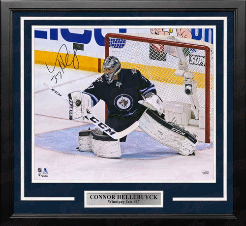 Connor Hellebuyck Blocker Save Winnipeg Jets Autographed 16x20 Framed Hockey Photo - Dynasty Sports & Framing
